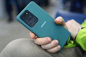 istock Man holding in hands Samsung Galaxy s20 Ultra closeup 1217881331