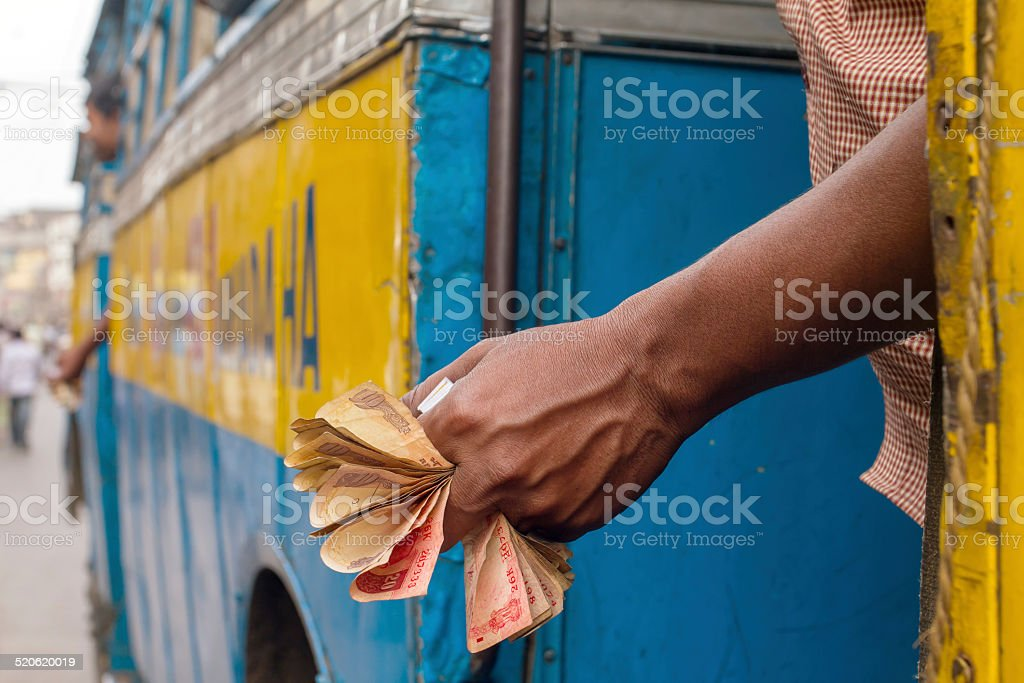 Man holding Indian rupee notes stock photo