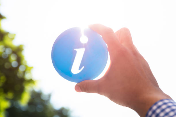 man holding information icon - tree logo stock photos and pictures