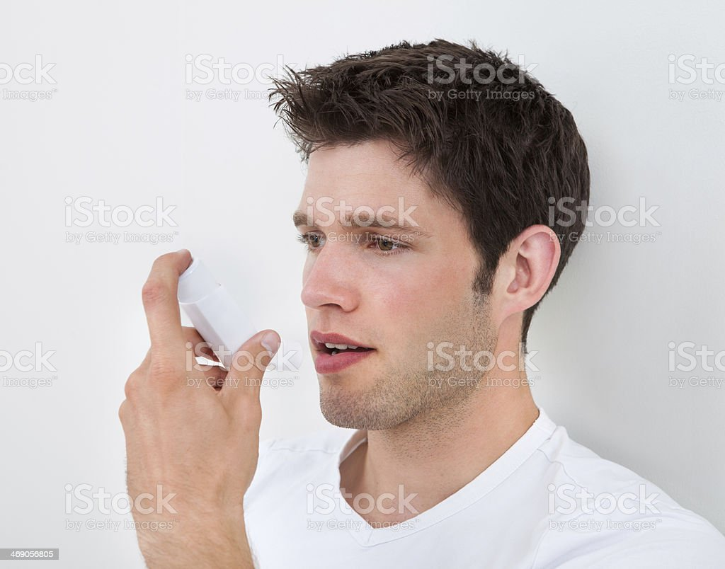 Man Holding Inhaler stock photo