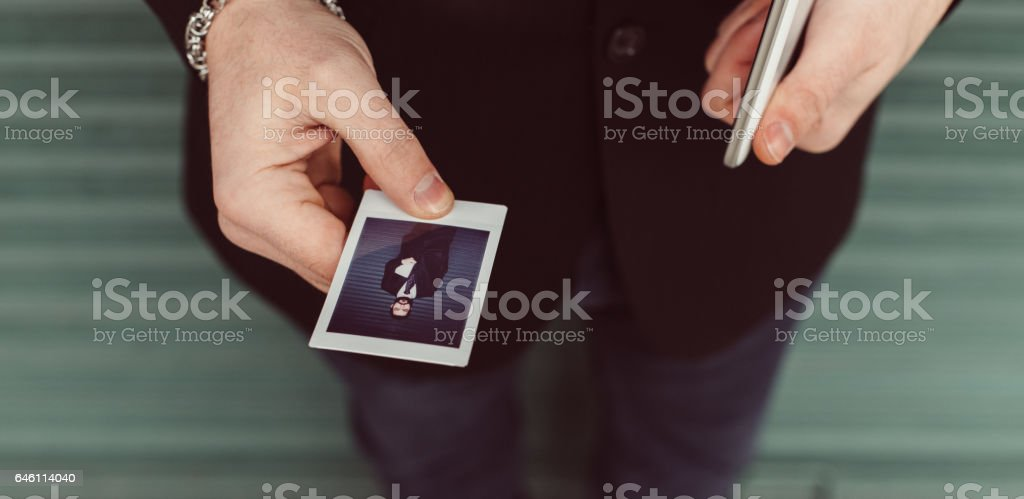 Man holding instant photo stock photo