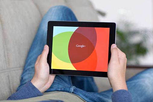 istock Man holding iPad with App Google on the screen 498211455