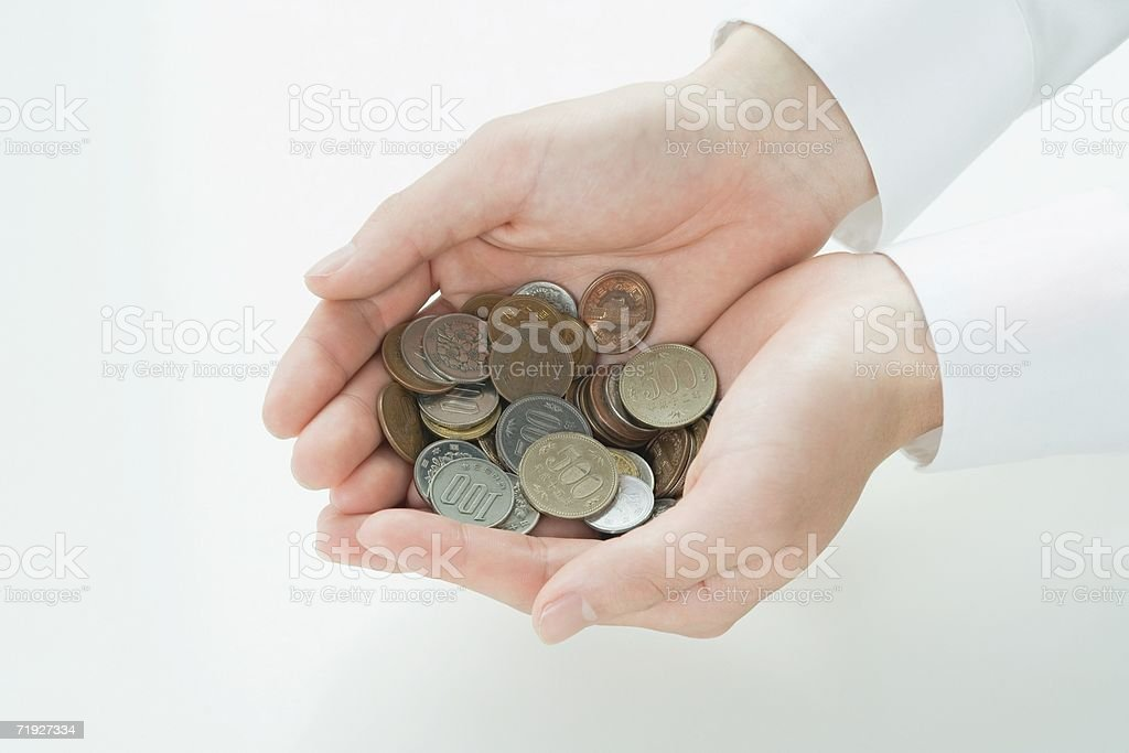Man holding japanese coins royalty-free stock photo