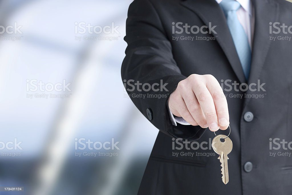 Man holding keys. Focus on keys royalty-free stock photo