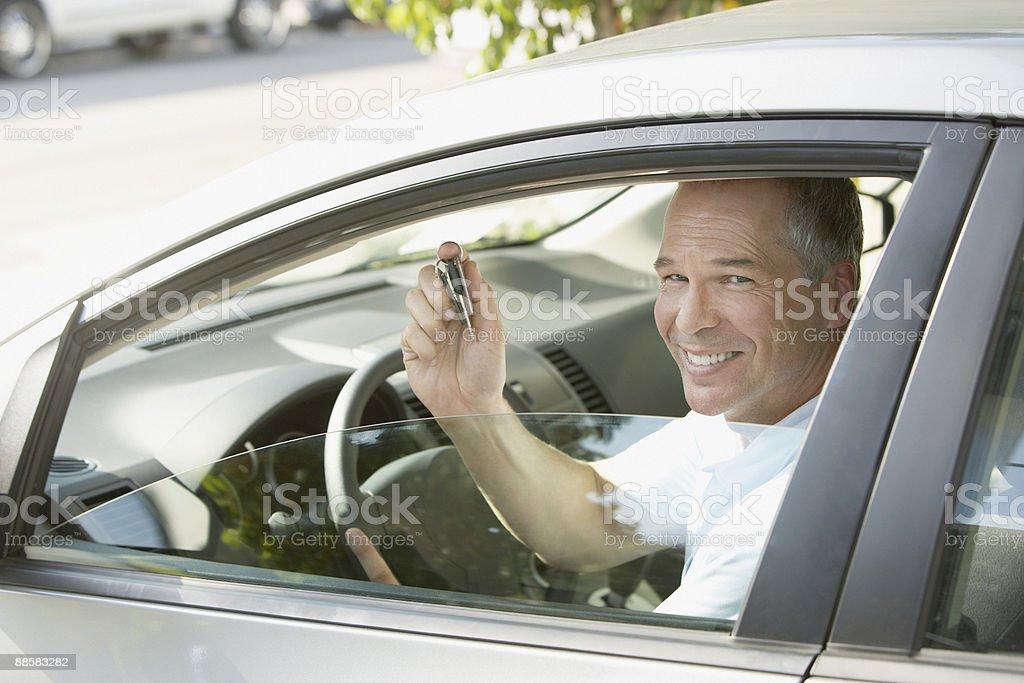 Man holding keys to new car royalty-free stock photo