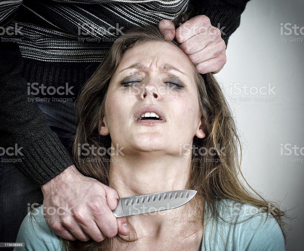 Man holding knife near woman's throat royalty-free stock photo