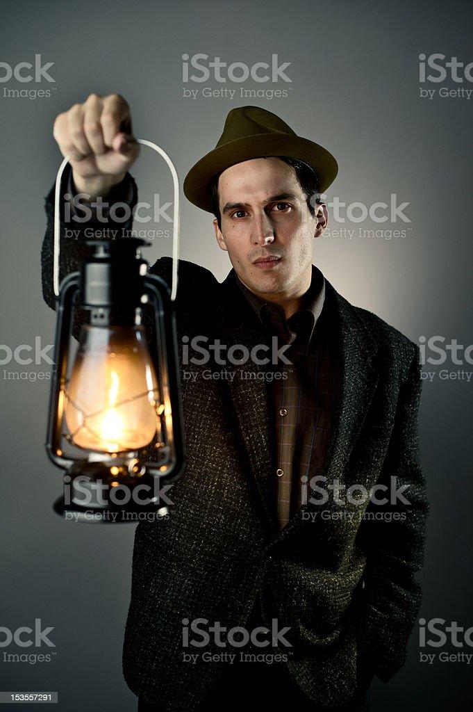 Man holding lantern royalty-free stock photo