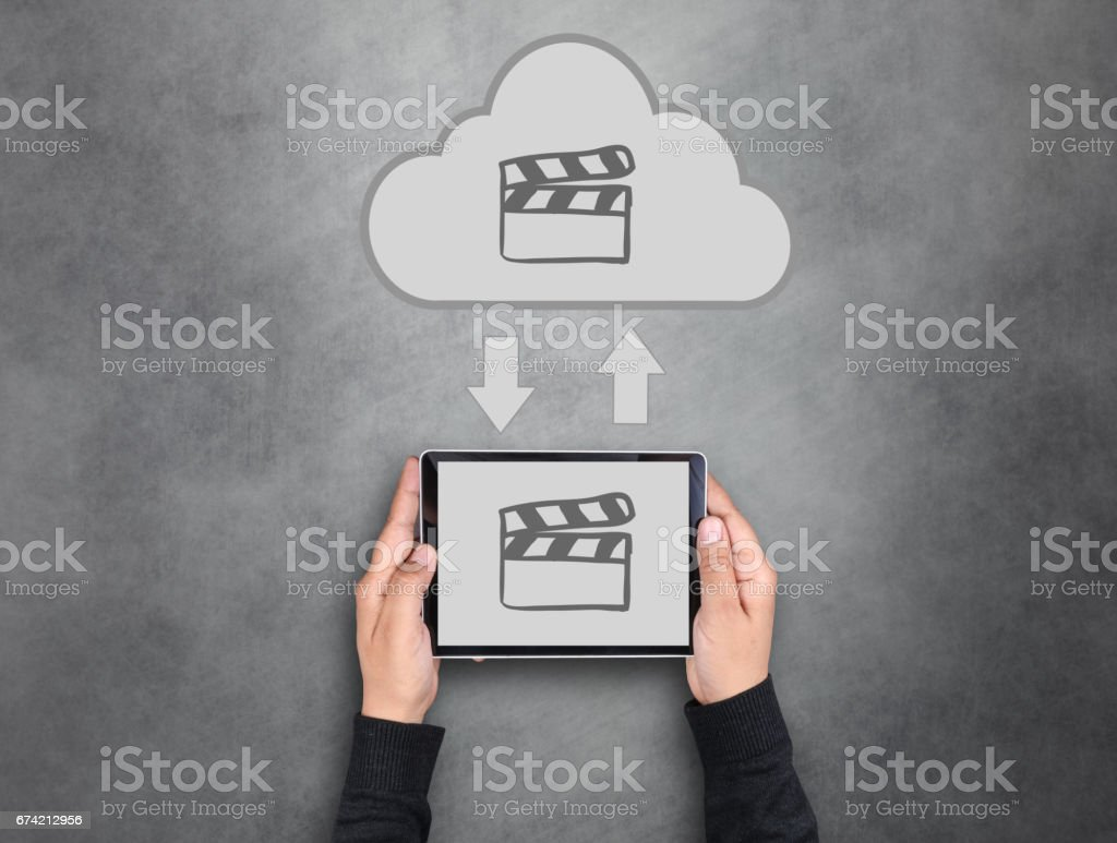 Man holding laptop with film slate cloud icon stock photo