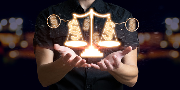 Man holding law paragraph and balance of justice. The icon of the balance of justice. Concept of legal advice, law and defense.
