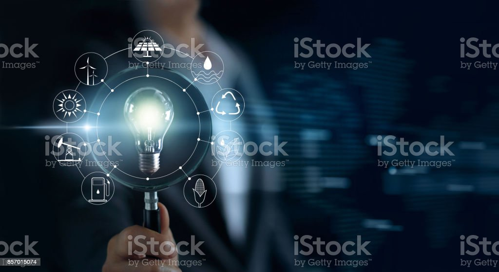 Man holding magnifying glass and light bulb ,search of global show the world's consumption with icons energy sources for renewable, sustainable development. Ecology concept stock photo