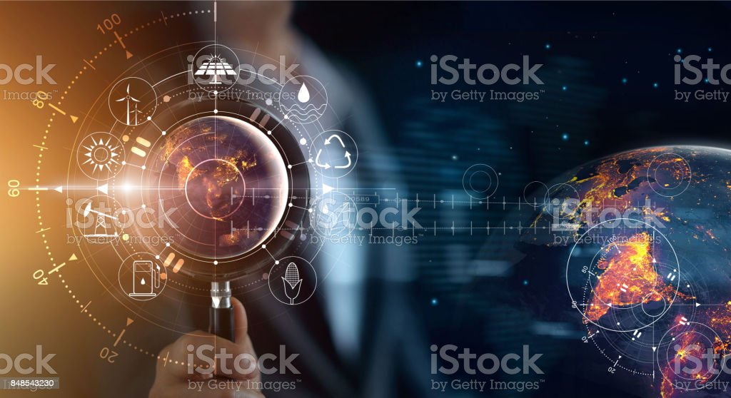 Man holding magnifying glass, search earth with lights in the night of global show the world's consumption with icons energy sources for renewable, sustainable development. Ecology concept. Elements of this image furnished by NASA. royalty-free stock photo