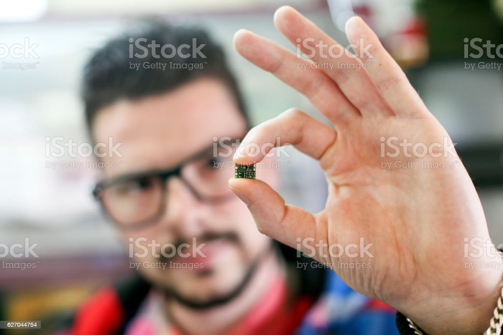 Man holding microchip stock photo