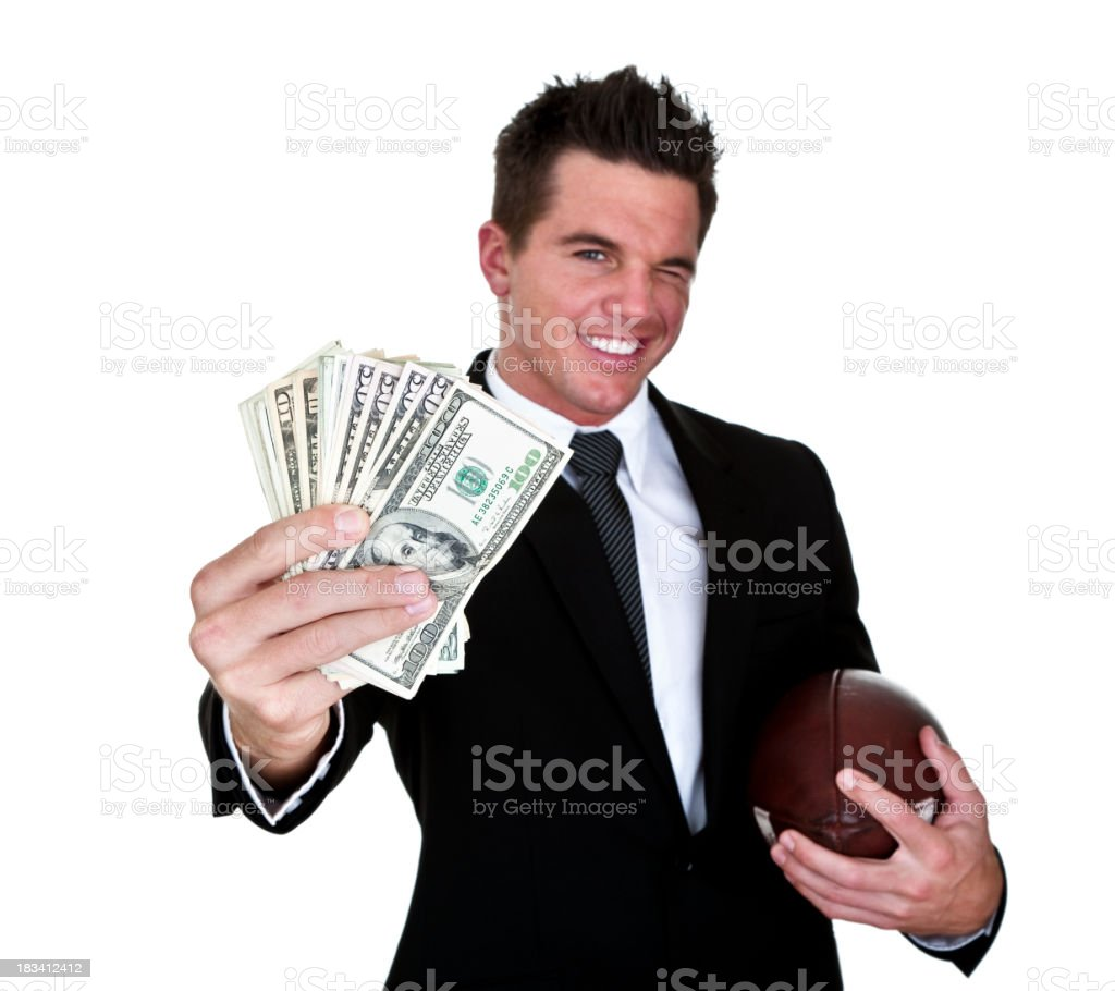 Man holding money and football stock photo