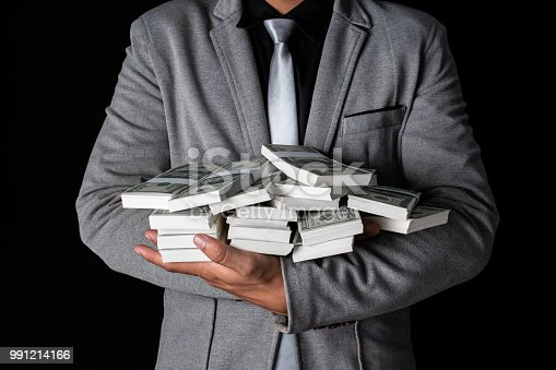 istock Man holding Money in hand at Black Background, Man receive a lot Money from Trading, Business Success Concept. 991214166
