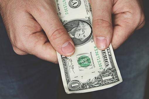 istock Man holding money in his hands. 1161231742