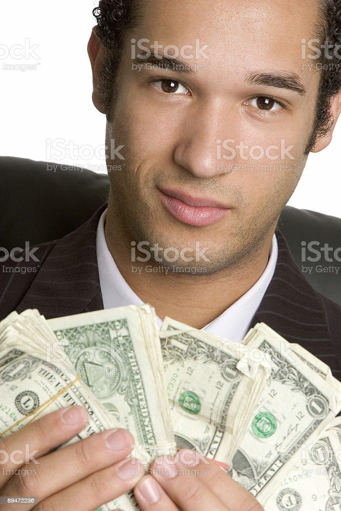 Mann hält Geld Lizenzfreies stock-foto