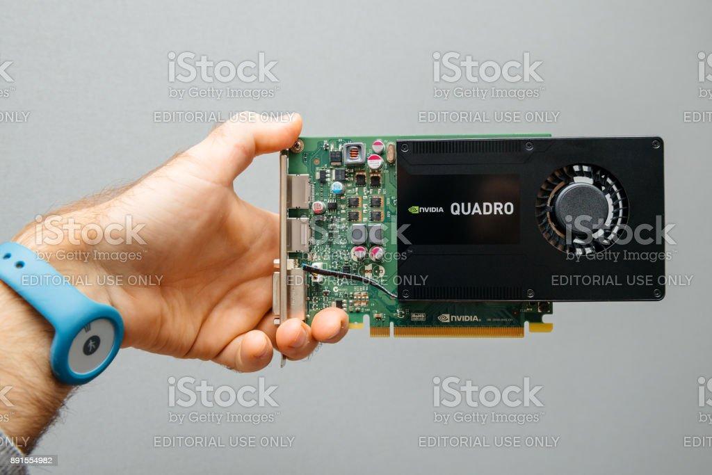Man holding Nvidia GPU Video card stock photo