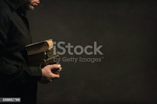 istock Man holding old Books in the Hands 536662766