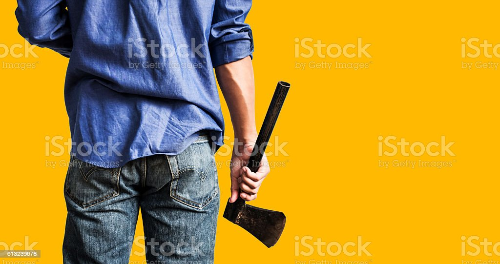 Man holding old rusty axe, on yellow background – Foto