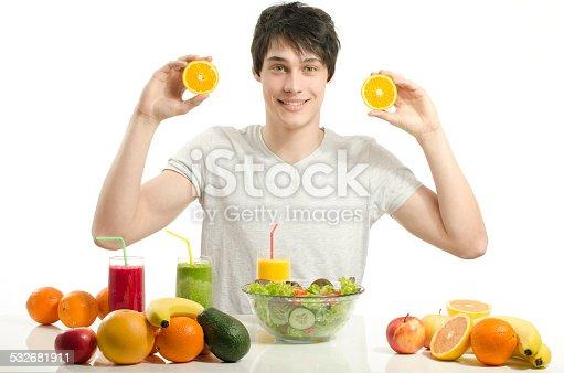 istock Man holding oranges,preparing salad, fruits, smoothie 532681911