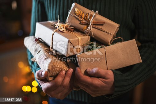 Unrecognizable male hands holding organic Christmas presents.