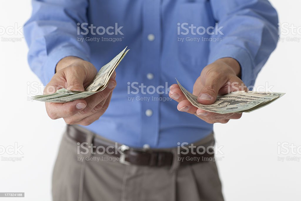 Man holding out cash royalty-free stock photo