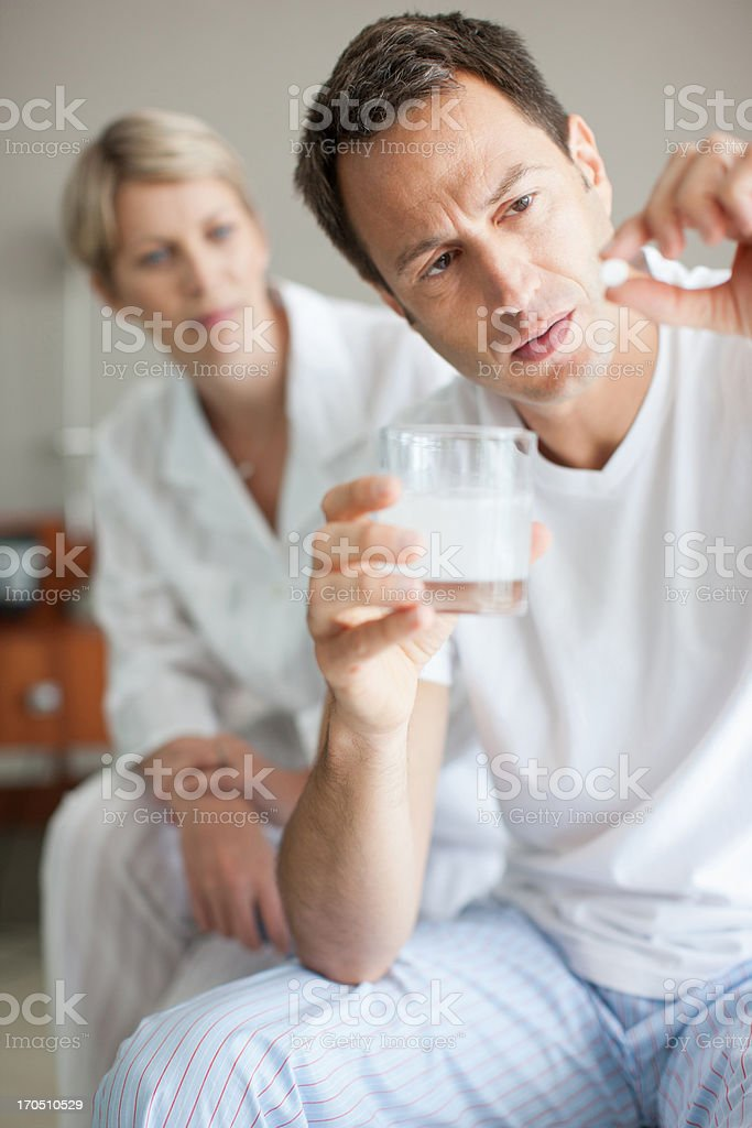 Man holding out medicine tablet royalty-free stock photo