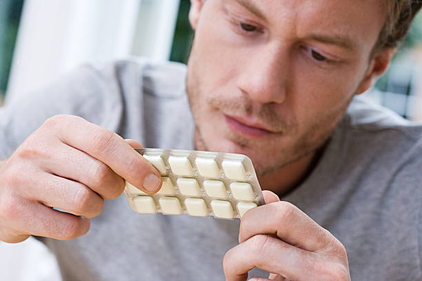 Man holding packet of nicotine gum  nicotine stock pictures, royalty-free photos & images