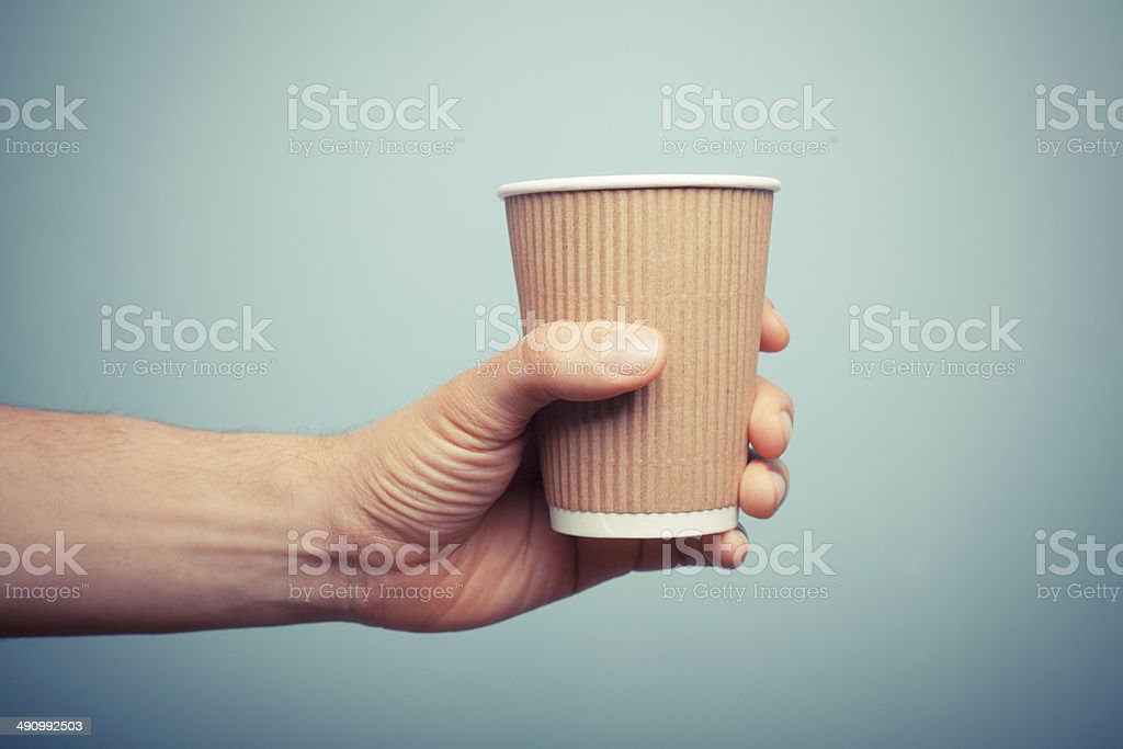 Man holding paper cup stock photo