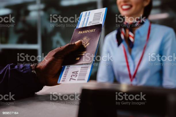 Man holding passport and boarding pass at airline checkin counter picture id959527164?b=1&k=6&m=959527164&s=612x612&h=izpj0p60juswa t1 fa333v9jjococdqmvmy02ahodc=