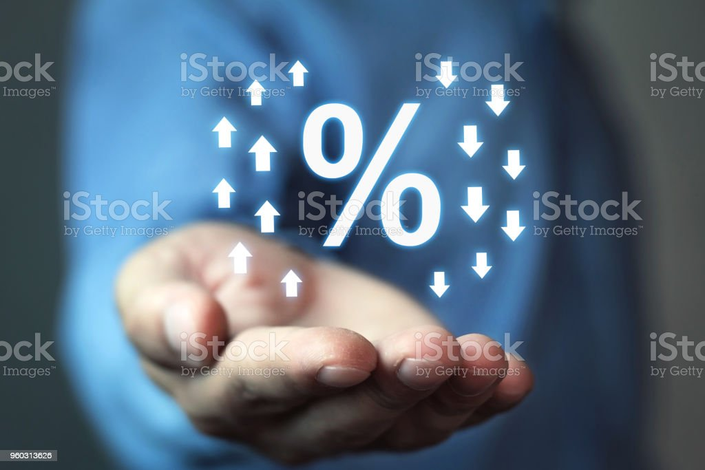Man holding percent sign with up and down arrows.