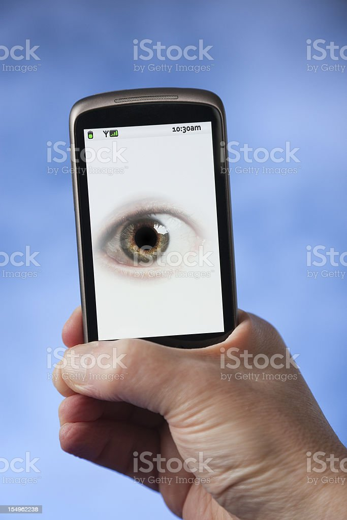 Man holding phone with a picture of an eye royalty-free stock photo