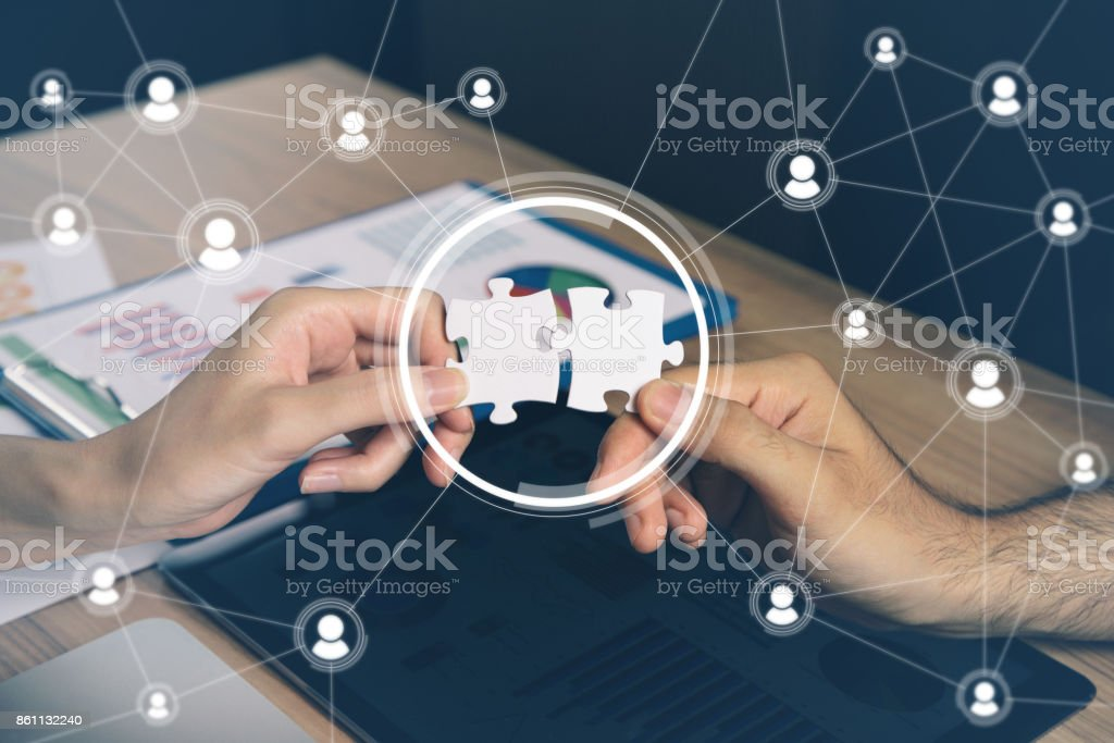 man holding pieces of jigsaw puzzle. business matching concept. crowd sourcing. freelancer. teleworking. - foto stock