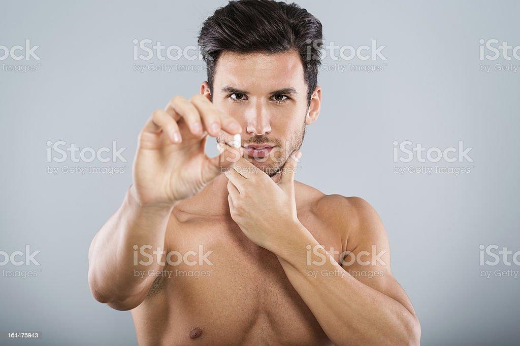 Man holding pill royalty-free stock photo