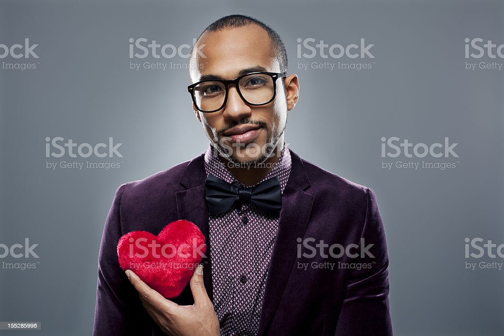 Man holding pink heart candy stock photo
