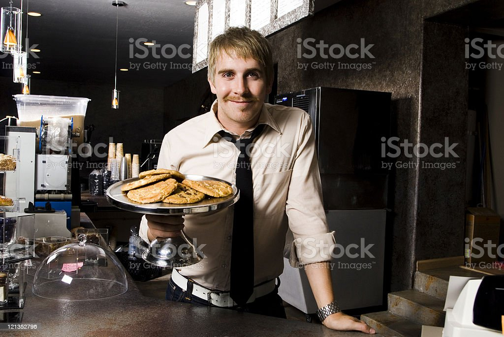 Man Holding Plate of Cooking at a Coffee Shop royalty-free stock photo