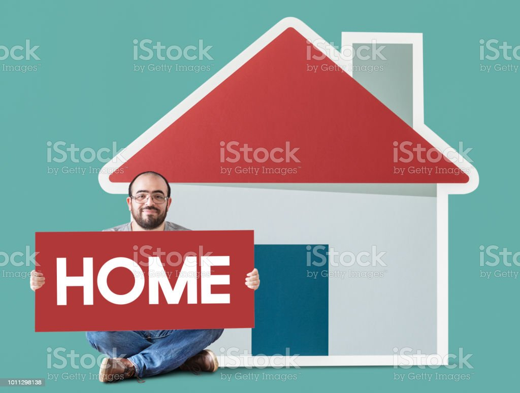 Man holding poster with house mockup stock photo