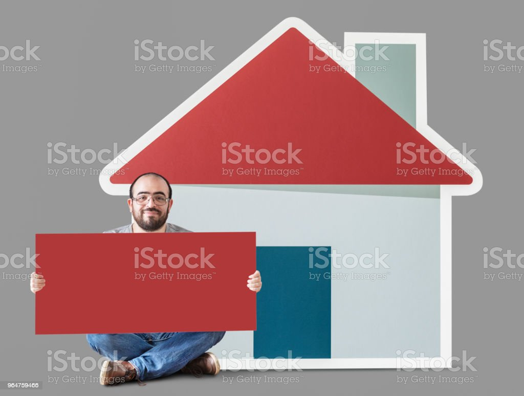 Man holding poster with house mockup royalty-free stock photo