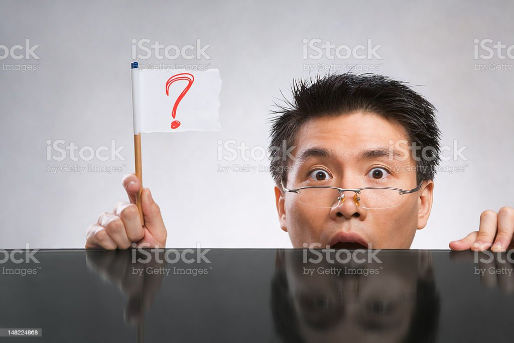 Man holding question mark flag royalty-free stock photo