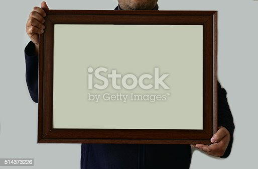 896826068 istock photo Man holding real picture frame 514373226