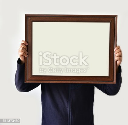 896826068 istock photo Man holding real picture frame 514373450