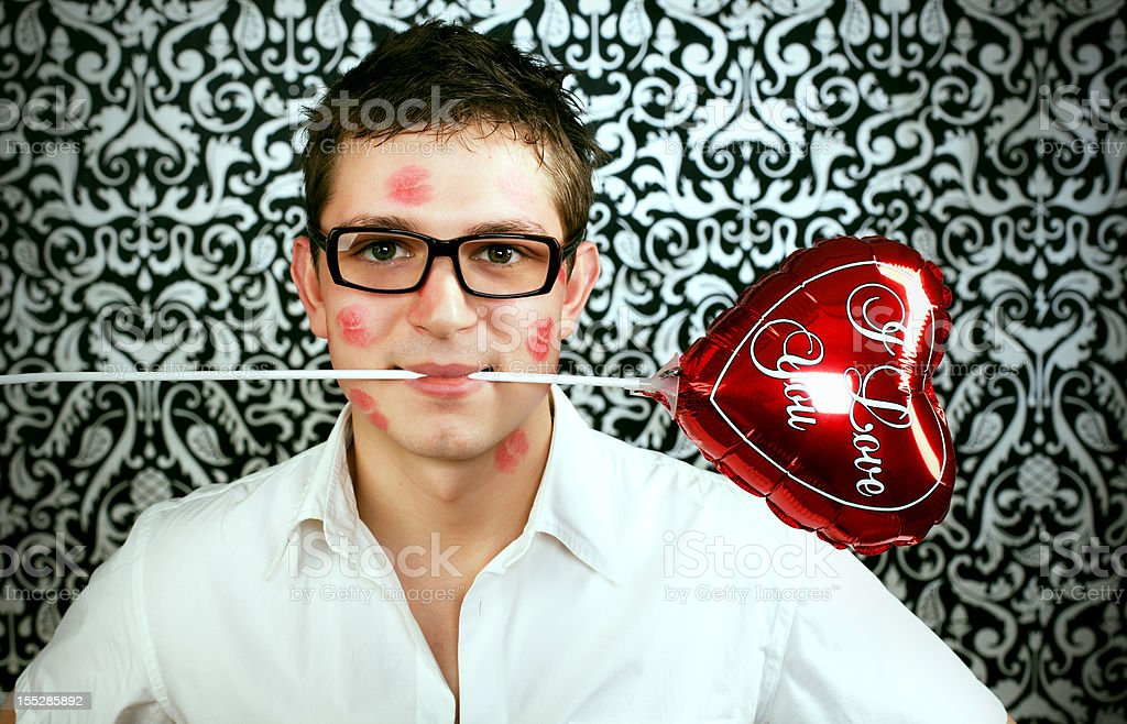 Man holding red heart baloon royalty-free stock photo