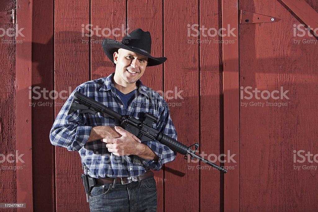 Man holding rifle stock photo