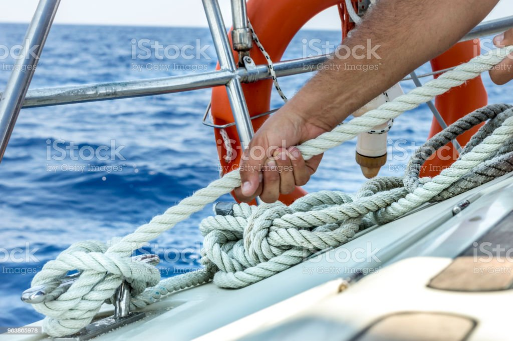 Man holding rope on sailing boat - Royalty-free Active Seniors Stock Photo