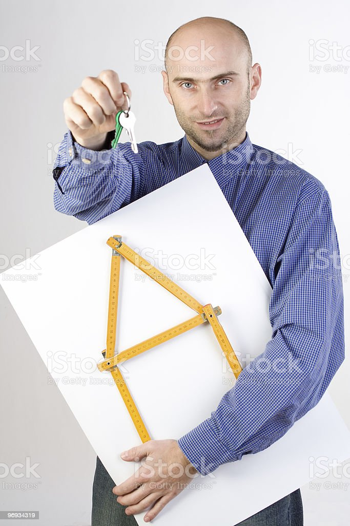 Man holding rulers and keys royalty-free stock photo
