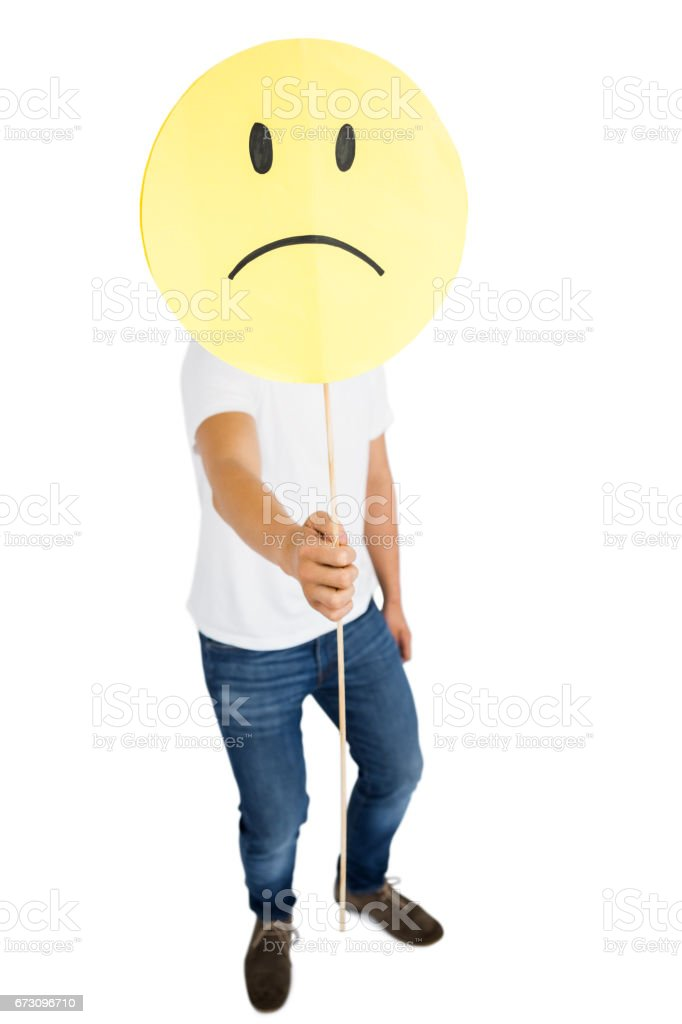 Man Holding Sad Smiley Face Stock Photo - Download Image Now