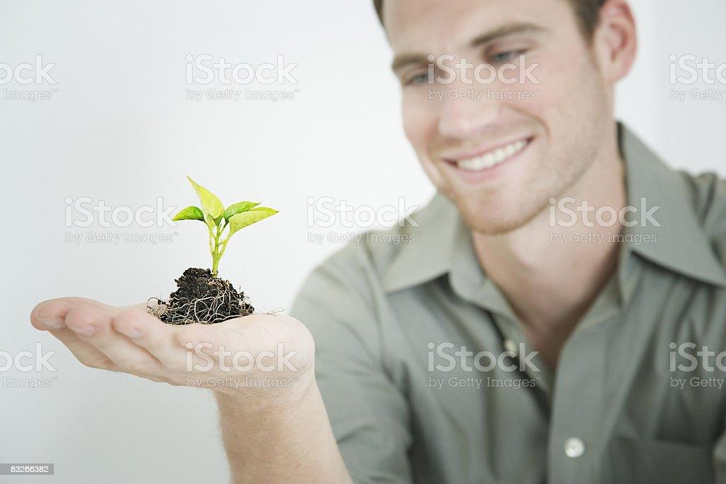 Man holding seedling royaltyfri bildbanksbilder
