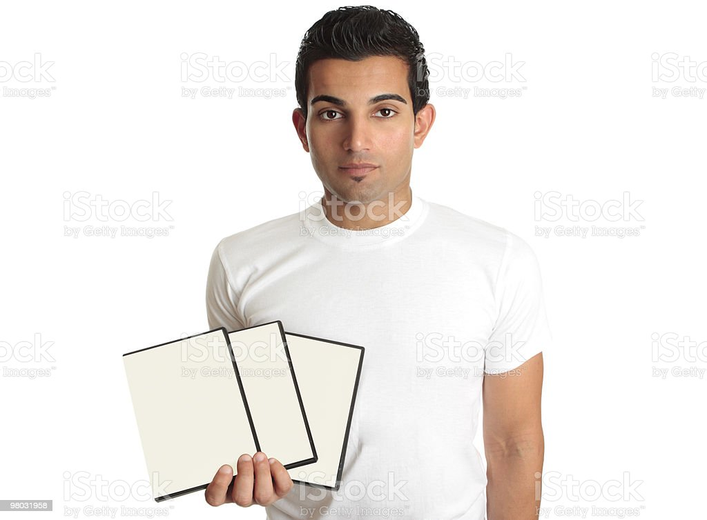 Man holding set DVD movies or games in his hand royalty-free stock photo