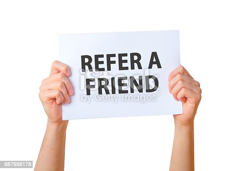 istock Man holding sign REFER A FRIEND . Business, technology, internet concept. Stock Photo 687968178