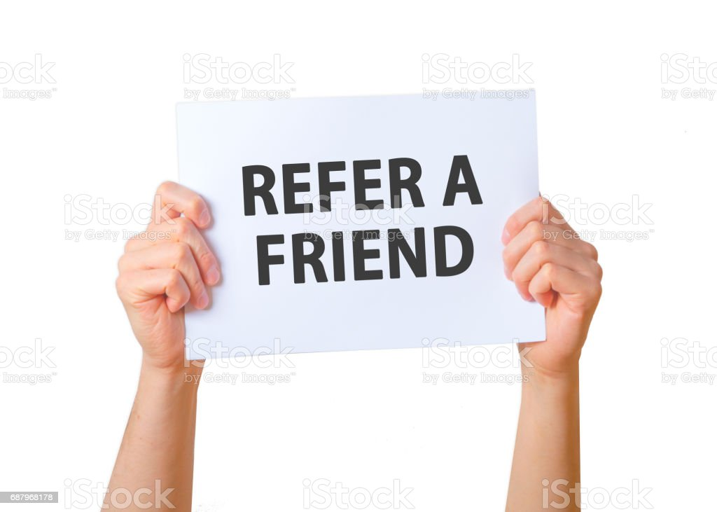 Man holding sign REFER A FRIEND . Business, technology, internet concept. Stock Photo stock photo